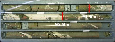 Figure 1 - HVD002 Drill core section (94.90m – 95.60m) showing zone containing visible gold mineralisation. (CNW Group/E79 Resources Corp.)