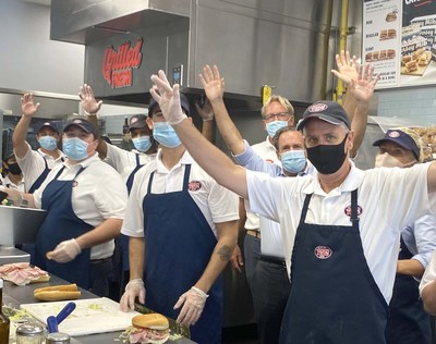 Jersey Mike's Founder & CEO Peter Cancro (third from right) celebrates 2021 Day of Giving on March 31.