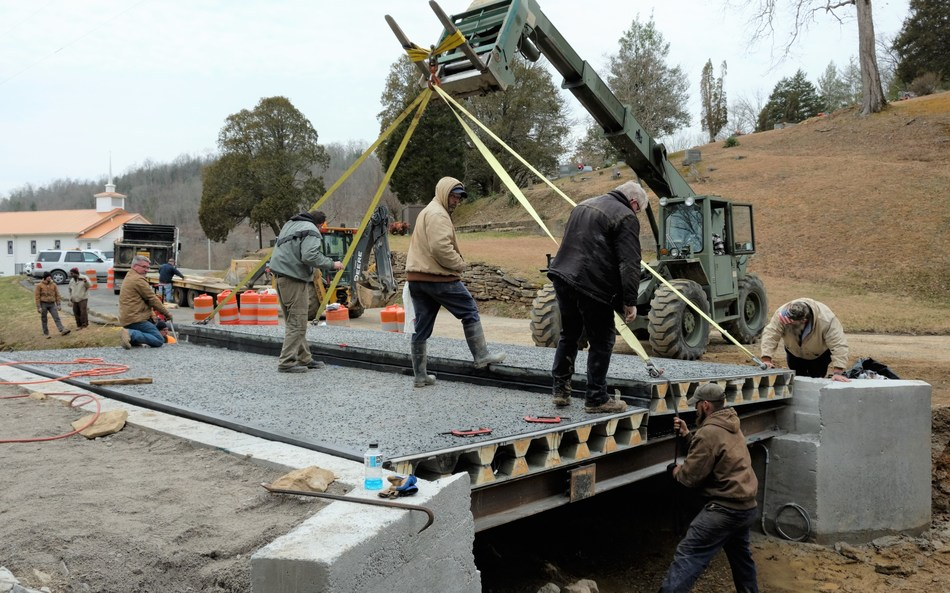 Two 8x25 feet composite bridge decks were manufactured offsite in a controlled environment, transported to the construction site in north central Tennessee, and installed in one day using a forklift.