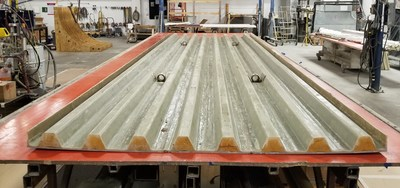 Developed by Structural Composites Inc., the composite bridge deck is comprised of two 8-by-25 foot fiber-reinforced polymer (FRP) deck panels that are engineered for high-strength, corrosion resistant and 90 percent lighter than concrete.