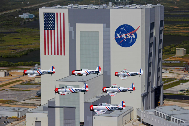 The GEICO Skytypers Air Show Team fly over the NASA Assembly Plant during a previous performance in the Space Coast of Florida.