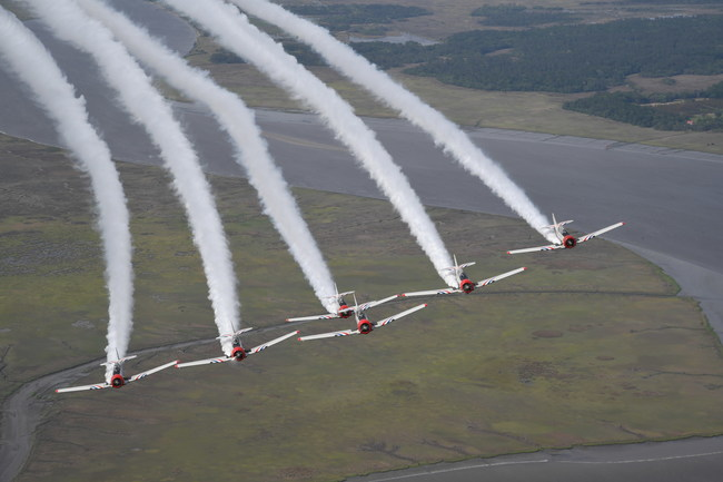 The GEICO Skytypers Air Show Team flies a delta formation over the waterways in the southeast.