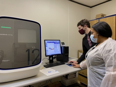 Lab staff evaluating the results of COVID-19 RT-PCR test using Quant Studio 12K Flex.