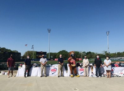 L-R: Representatives from College of Charleston baseball; representatives from Suburban Propane; Charlie, the Charleston RiverDogs mascot; representatives from Lowcountry Orphan Relief; and representatives from Tanger Outlets.