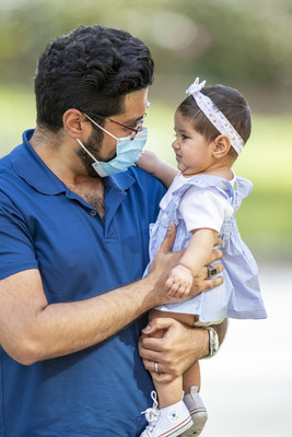 Jude patient dad Khurram with his daughter, Imani, at St. Jude Children's Research Hospital. Khurram and his wife, Sarah, were faced with their baby daughter's brain cancer diagnosis just weeks after welcoming her into the world. Imani received lifesaving treatment at St. Jude.