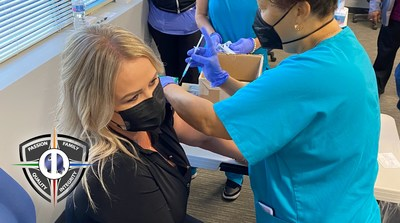 Christy Doyle, the Chief Human Resource Officer at Quality One Wireless, receives the first dose of the Moderna mRNA COVID vaccine at Q1's Orlando facility on Tuesday, April 13th.