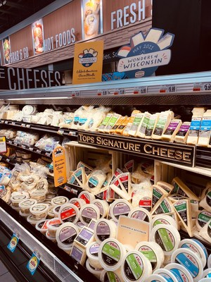Look for the Wonders of Wisconsin displays at nearly 6,000 grocery store locations throughout May as retailers nationwide put a spotlight on Wisconsin specialty cheeses during American Cheese Month. (PRNewsfoto/Dairy Farmers of Wisconsin)