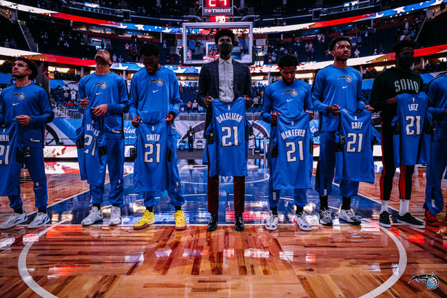 Each Orlando Magic player during the National Anthem prior to Sunday's game against the Houston Rockets held up a jersey that had a name of a fallen U.S. soldier listed on the back. Each family received/will receive the signed jersey.