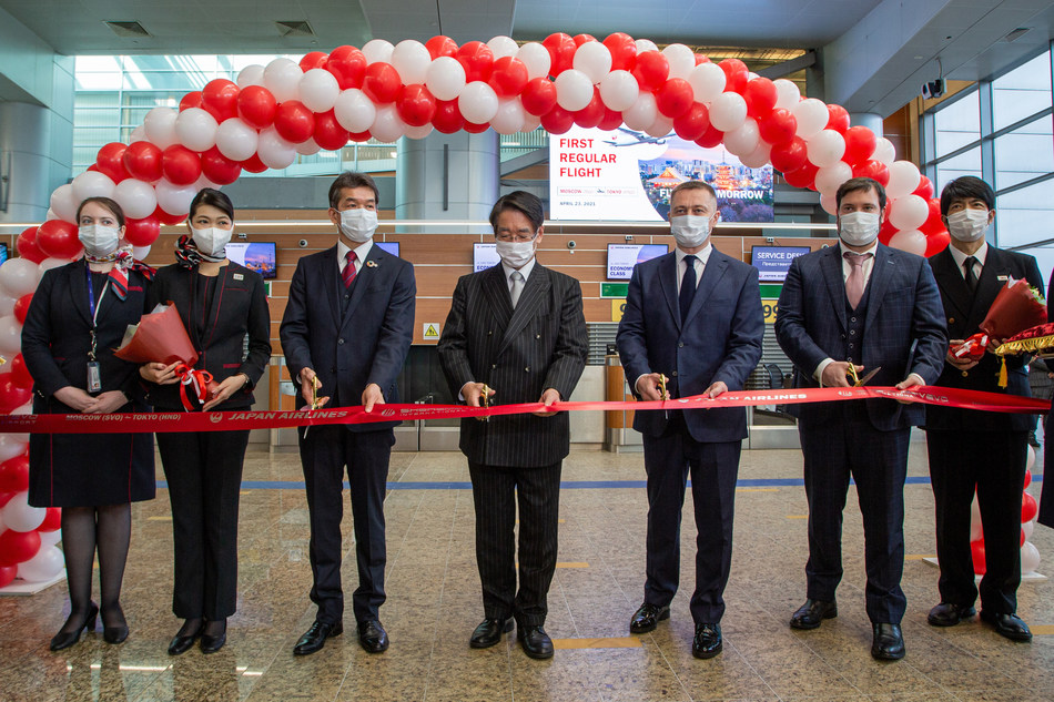 The resumption of flights on Japan Airlines between Moscow's Sheremetyevo International Airport and Tokyo's Haneda Airport is celebrated with a ribbon cutting at Sheremetyevo.