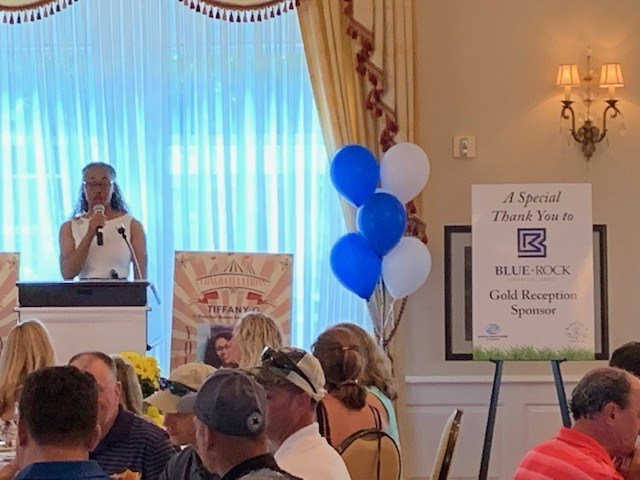 Picture from the 2019 Golf Outing with our sponsorship banner front and center.