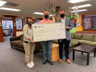 PenFed presents Ophelia's Place with a $5,000 donation. From left to right: Ophelia's Place Vice President of Programs Laura Sanchez, Vice President of Development Hadee Sabzalian and PenFed SVP Regional Service Center Chris Martin.