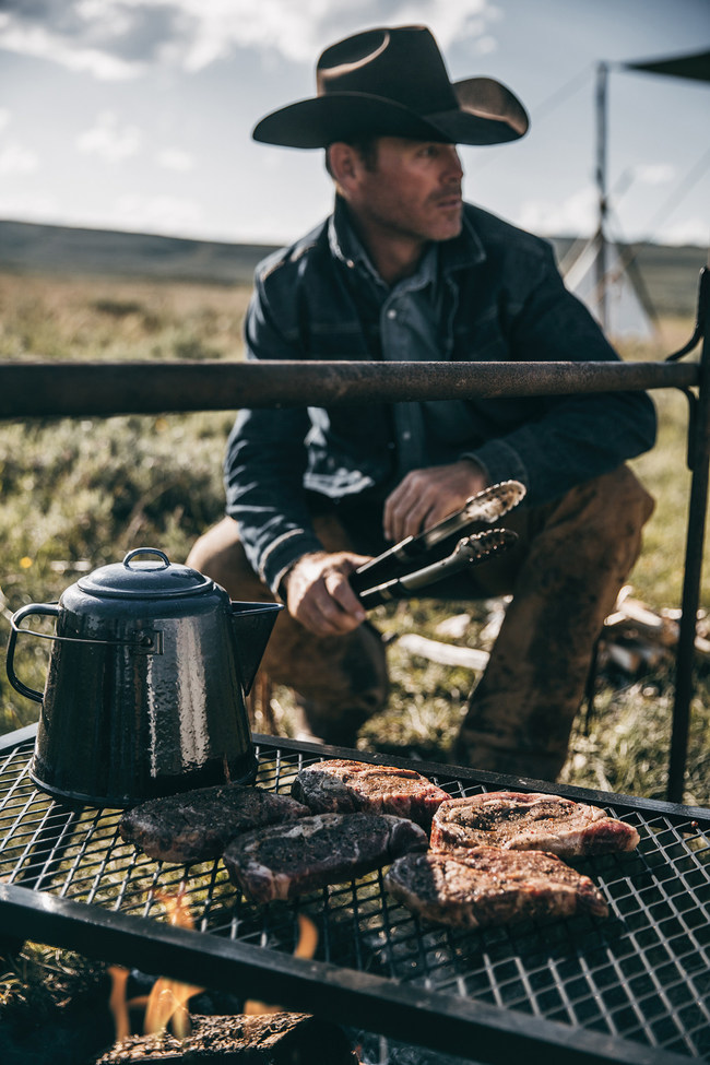 Cowboy grilling all natural premium Angus steaks from the Wellborn 2R Ranch.