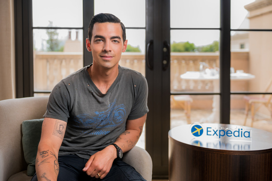 Joe Jonas pictured on site with Expedia for an exciting project that will support travelers as they prepare to travel again.