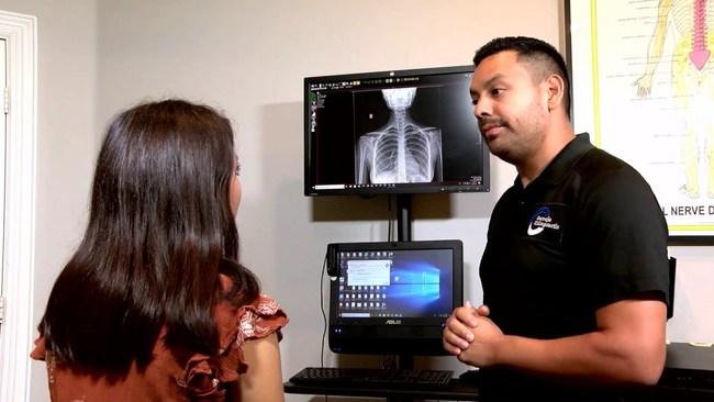 Dr. Luis Cornejo with a patient