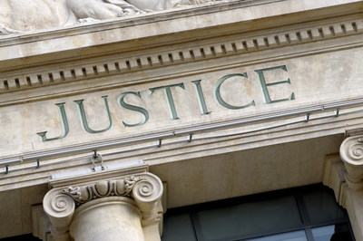 Justice sign on a Law Courts building.  New high resolution version shown below: