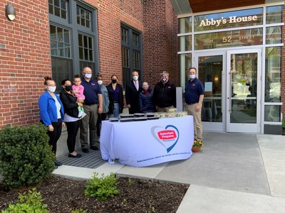 Representatives from Suburban Propane and staff and beneficiaries of Abby's House, along with Worcester, MA Mayor Joseph M. Petty (pink tie) and XLO 104.5, at Suburban Propane's catered Mother's Day celebration.