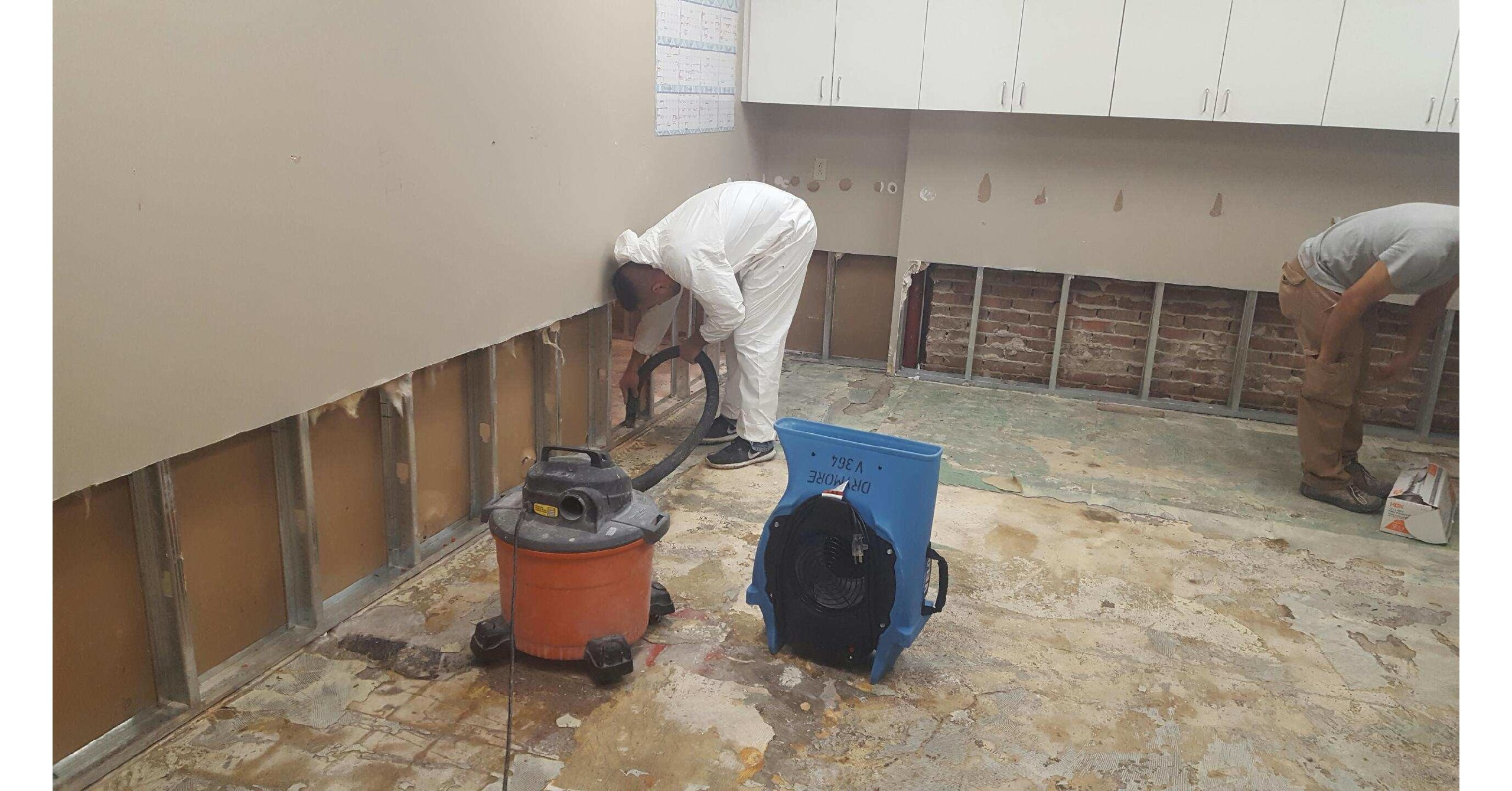 A DryMore technician removes damaged drywall jpg?p=facebook.