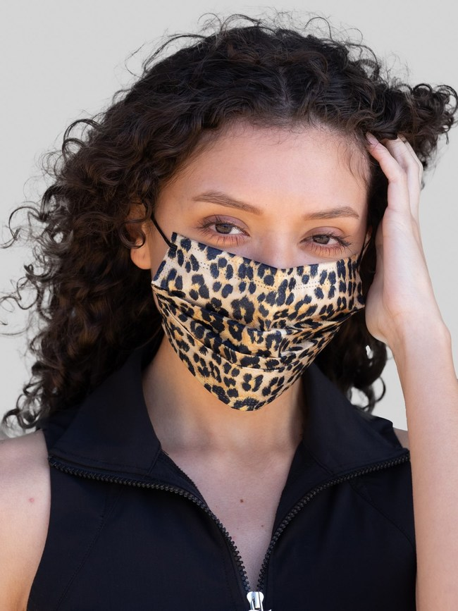 imask4u Juicy Couture fashionable designer 3-ply disposable mask looks like a fabric mask but without the upkeep. Just wear it and toss it. Shown in leopard print.