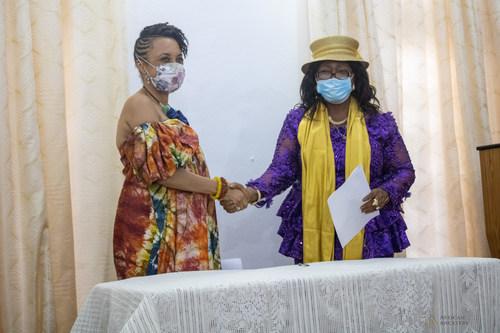 AfricanAncestry.com's Gina Paige and Sierra Leone Minister of Tourism Madam Memunatu Pratt Sign Historic Citizenship Agreement in Freetown, Sierra Leone on April 29, 2021