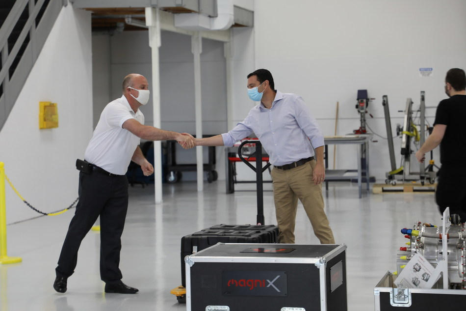 Ganzarski (left) and Bar-Yohay (right) shake hands as the electric propulsion units are delivered to Eviation's facility in Arlington, Wash.