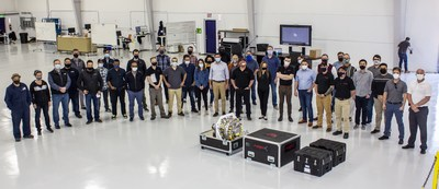 Members of magniX and Eviation during the delivery of the electric propulsion units.