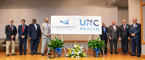 Members of CarolinaEast Board of Directors, CarolinaEast Health System CEO/President Ray Leggett and UNC Health Chief Operating Officer Steve Burriss celebrate the announcement of a comprehensive affiliation between the two award-winning organizations. This collaboration will help strengthen rural healthcare throughout the Eastern Region.
