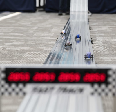 Mini Soap Box Derby cars on the racetrack