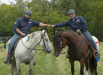 Veterans Alex Rodriguez and Victor Ayala fist bump on horseback. BraveHearts riding and educational center will present at Vets 4 Veterans' Families, June 26 in Crystal Lake, Illinois.