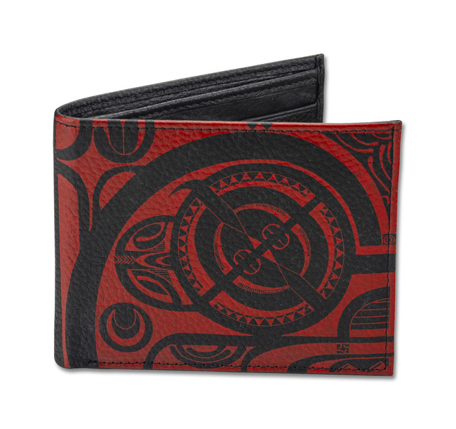 Tattoo artist Che Pilago draws on his Hawaiian, Marquesas, and Tahitian heritage in this tribal tattoo design for a bifold wallet by NA KOA Leather. The overall design is primarily in a very modernized the French Polynesian style, with some traditional motifs like tiki eyes and the enata pattern to signify a tiki. Che's tattoo wants to inspire the wallet's owner to look and move forward in life.