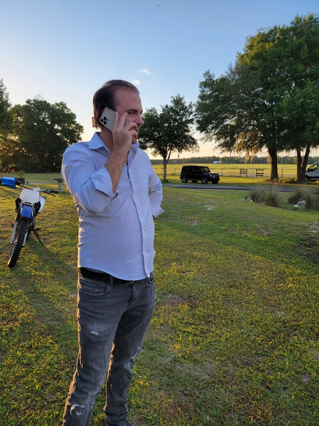 Caleb Walsh Fund Director observing future site of a multi family development