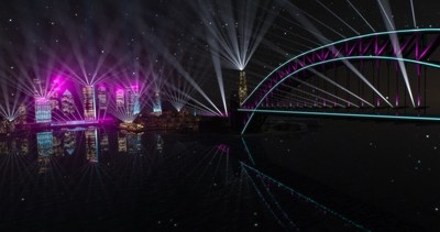 Our Connected City by Mandylights, supported by Transgrid, will shine new light on the city's landmarks, with over 200 searchlights beaming across the Harbour, CBD buildings and the Cahill Expressway, linking the Sydney Opera House and Sydney Harbour Bridge in riotous colour.