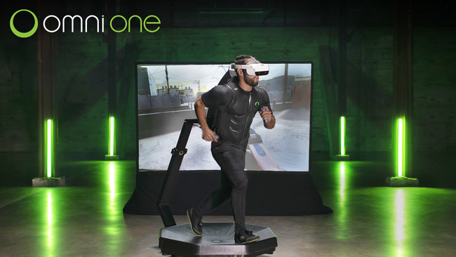 A players walking on the Omni One virtual reality treadmill.