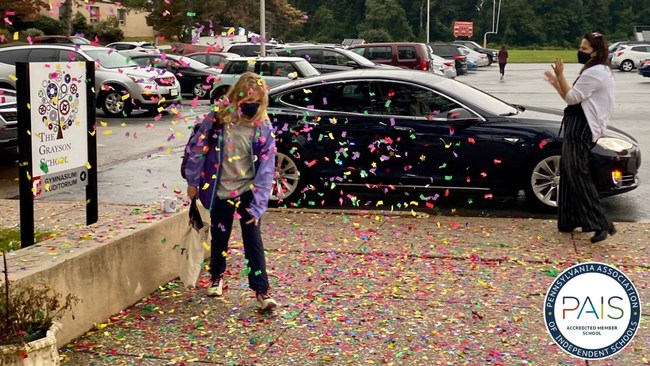 Head of School, Melissa Bilash gives a congratulatory welcome to students arriving on campus.