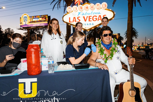 """Touro University Nevada, home of the state's largest medical school and only school of osteopathic medicine, hosted a pop-up COVID-19 vaccination clinic at the world-famous """"Welcome to Las Vegas"""" sign on Monday, May 24. Coined """"Vaccines after Dark,"""" and co-hosted by Clark County Commissioners Justin Jones and Michael Naft, along with US Rep. Dina Titus, the pop-up event drew nearly 100 people who received vaccinations administered by Touro School of Physician Assistant Studies students, includin"""
