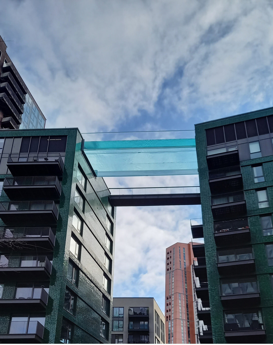 Reynolds Polymer completed the world's first ever floating Sky Pool for Embassy Gardens in London, England. The tototally transparent acrylic pool spans 83 feets across two buildings, 115 feet in the air.