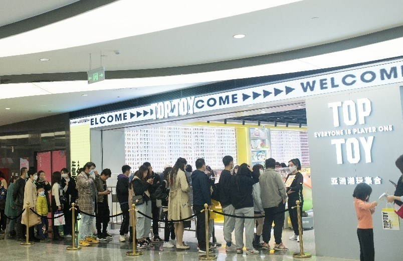 Customers queue at the register at TOP TOY in Lanzhou, a Tier 2 city in China, where purchases broke initial sales estimates