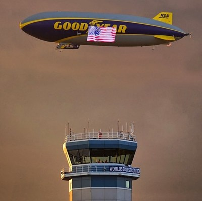 The Goodyear Blimp flies over EAA AirVenture Oshkosh's Air Traffic Control Tower.