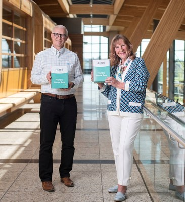 Nancy Southern, Chair & Chief Executive Officer, ATCO, and Marshall Wilmot, President, ATCO Energy Ltd & Chief Digital Officer, celebrate the launch of Rümi with Happy Home Boxes filled with items to make life easier around the home. (CNW Group/ATCO Ltd.)