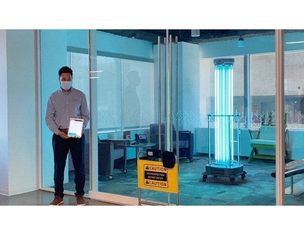 UBTECH technician uses app to prompt robot to disinfect air and surfaces of office space at Coretrust Capital Partners' property.