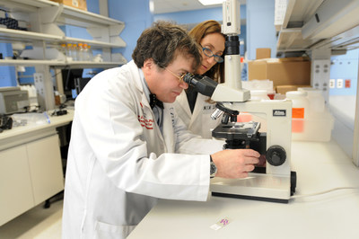 Drs. Peter Hotez and Maria Elena Bottazzi, co-directors of Texas Children's Center for Vaccine Development, working in their lab; Photo courtesy by Anna Grove Photography
