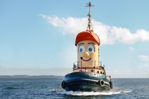 Theodore TOO navigue fièrement à travers le front de mer d'Halifax près du Musée maritime de l'Atlantique. (Groupe CNW/BWTT Holdings Inc.)