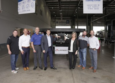 RV Retailer's Chief Marketing Officer and Chief Technical Officer Famous Rhodes (far left) and Jon Ferrando, CEO and President, alongside LCI executive team