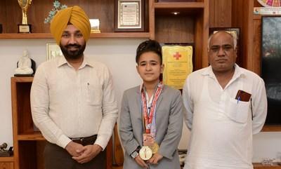 Chancellor Chandigarh University Satnam Singh Sandhu along with Taekwondo player Aruna Tanwar and her father Naresh Kumar
