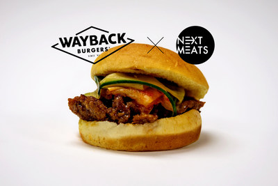 The East Meats Next® burger, featuring the NEXT® Yakiniku short rib, grilled and topped with fresh kimchi & ponzu cucumbers.