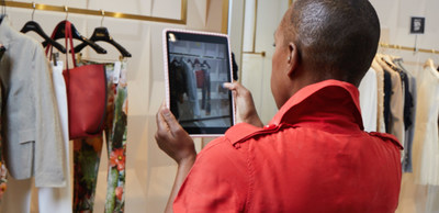 A Neiman Marcus selling associate using the CONNECT remote-selling platform