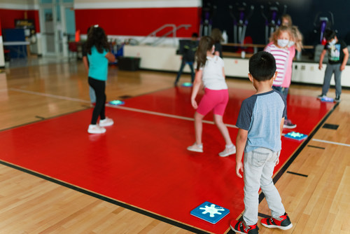 Students at Garland Quarles Elementary playing games with Unruly Splats in PE.