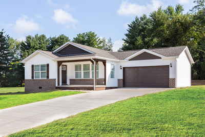 A Clayton CrossMod home with porch and garage is an innovative example of today's manufactured housing.