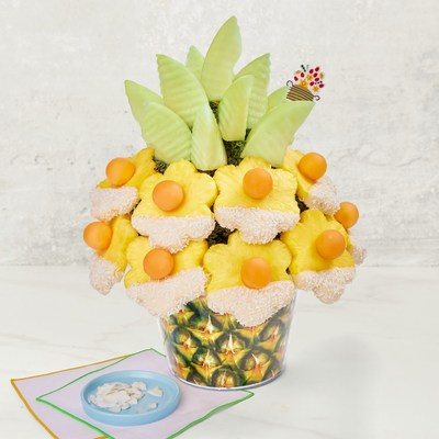 The new, fresh and fruity Pineapple Pina Colada flavor is featured in Edible's Pineapple Pina Colada Bouquet. The arrangement includes a juicy pineapple daisy partially dipped in white chocolate and topped with coconut, then crowned with crisp honeydew wedges.