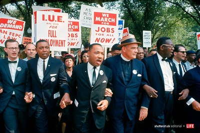 Leaders of March on Washington for Jobs & Freedom marching with signs in 1963 (R-L): Matthew Ahmann, Floyd McKissick, Martin Luther King Jr., Rev. Eugene Carson Blake and unident. Photo credit: Robert W. Kelley/The LIFE Picture Collection/Shutterstock.