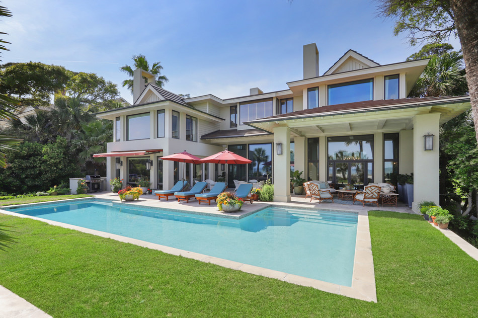 An oceanfront estate located in exclusive Sea Pines Resort on Hilton Head Island boasts more than 7,500 square feet with 5 bedrooms, 5 bathrooms and 2 powder rooms — the perfect family vacation home!